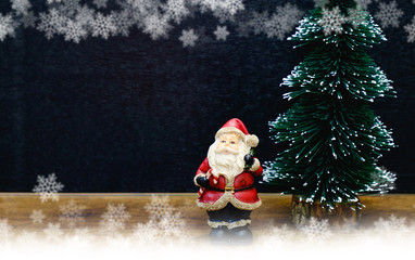 Snow man statue and a clock near midnight time with a copy space, Christmas decorated concept