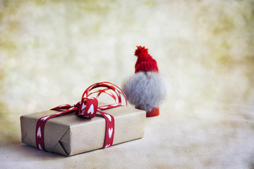 Handmade christmas gift box whit ribbons shapes heart, elf on abstract background. Selective focus and copy space