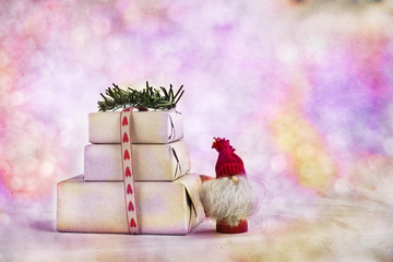 Three handmade Christmas gifts boxes with rustic packagking on abstract background. Copy space