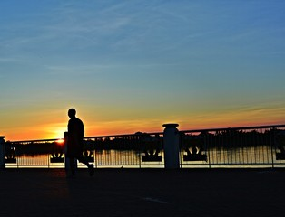 A man jogging in evening sunset background .