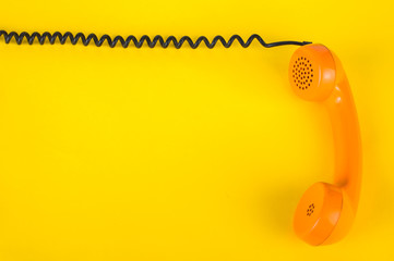 Orange handset on a yellow background