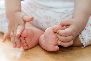 One year old old baby hands and feet closeup