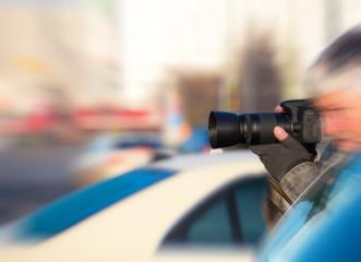A paparazzi secretly takes photos