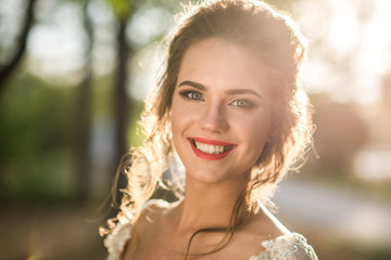 Radiant beautiful bride, portrait of a woman outdoor A big smile