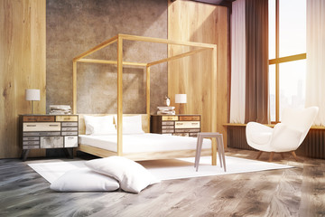 Side view of a bedroom with pillared bed, toned