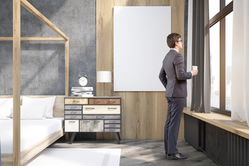 Businessman with cup of coffee in a bedroom