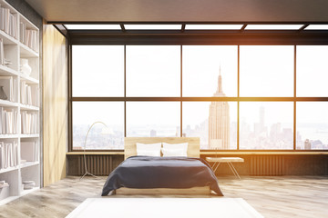 View of New York bedroom with poster and bookcase, toned