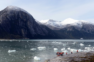 Tourists from the cruise ship landed on the shore near Pia glacier.