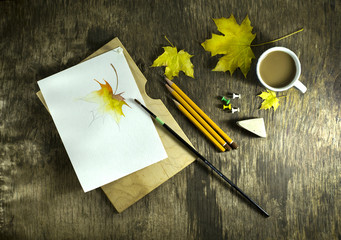 Art brush with sketches and autumn leaves