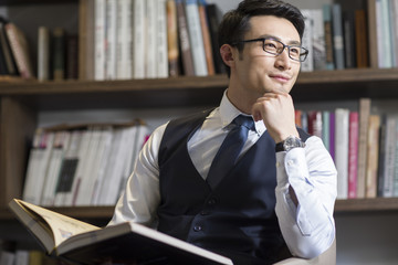 Young businessman thinking in his study