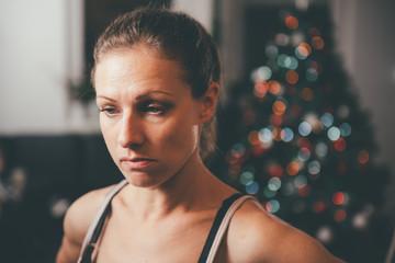 Sad woman by the christmas tree