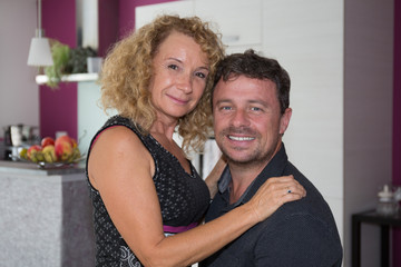 Cheerful in love couple enjoying being at home
