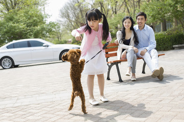 Happy young family with their pet dog