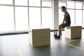 Young man sitting at gym