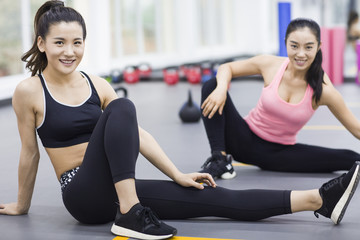 Young women resting at gym