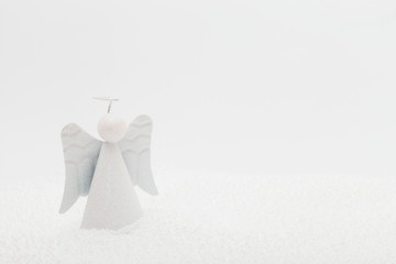 Angel ornament in fake snow