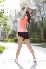 Happy young woman exercising in the morning