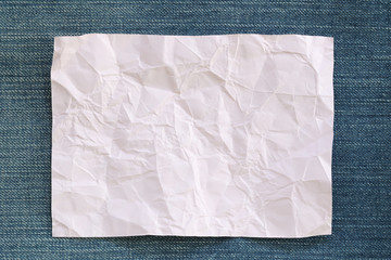Note paper crumpled of empty and copy space on Denim background.