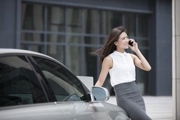 Confident businesswoman talking on cell phone