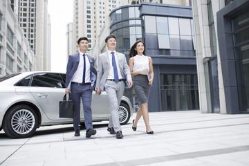 Business people walking outside office buildings