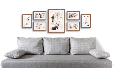 Interior decor mockup.Frames collage with floral posters over modern couch,