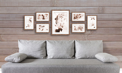 Frames collage with floral posters on wooden panels wall over modern couch, interior decor mockup