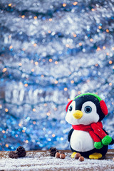 Cute Happy Penguin Christmas Toy Smiling On Snowy Wood.