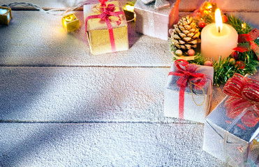 close up view  of gifts boxes  on snowbound  wooden back