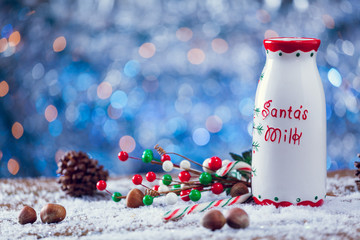 Old Fashioned Santa Claus Milk Jug On Snowy Wooden Background