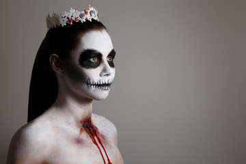 makeup for halloween. gray background, isolated. unusual body art