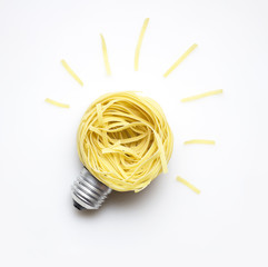 Food idea / Creative concept photo of  a bulb made of pasta on white background.