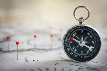 Fototapete - Magnetic compass on a world map conceptual of global travel , tourism and exploration. Macro photo.