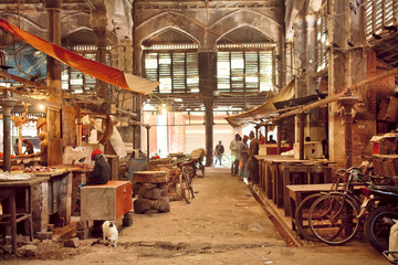 End of working day inside of grunge hall of old city market with historical counters