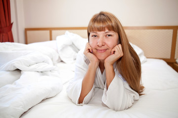 Young woman lying on the bed in the morning