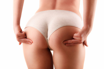 Sexy female buttocks isolated on white background
