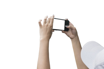 Hand of a woman taking a picture with a smart phone isolated on white background.