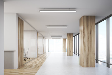 Office with wooden columns and conference rooms