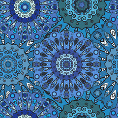 Print Blue colored seamless pattern with eastern floral orament. Floral oriental design in aztec, turkish, pakistan, indian, chinese, japanese style.