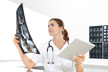 Radiologist woman checking xray, with tablet, healthcare, medical concept