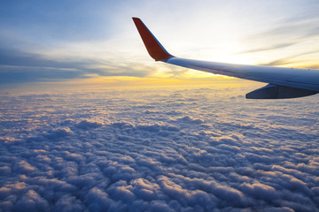 Sunrise and beautiful cloud view from window of aircraft