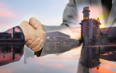 Double exposure of business women double handshake and Electric Generating Factory as Investment in energy concept.