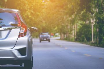 Close up back side of new silver hatchback car parking on the asphalt road in vintage tone