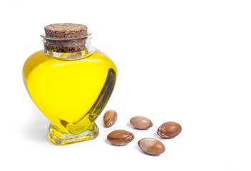 Bottle with oil. Cosmetic means. Food product. Jar with argan oil on the isolated background.