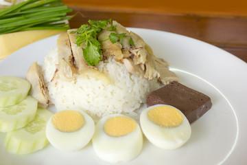 Hainanese chicken rice boil egg on white plate