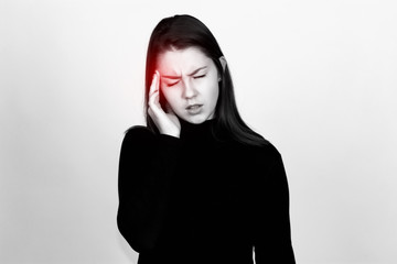 Portrait of a pretty woman in turtleneck sweater over gray background stress and headache having migraine pain black and white with red accent