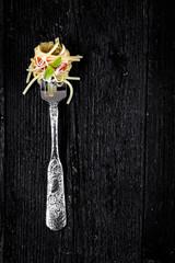 Italian pasta with tomato on fork
