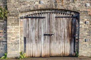 Vintage padlock on wooden gate