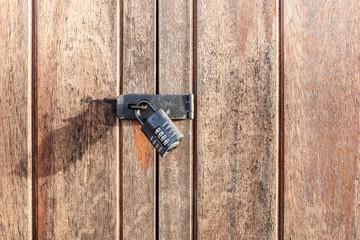 Vintage padlock on wooden gate Wall mural