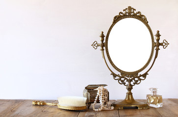 Old vintage oval mirror and woman toilet fashion objects