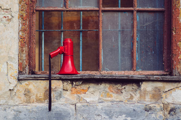 Megaphone on the old windowsill